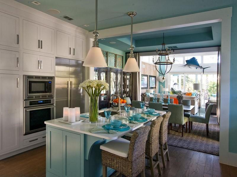 Стальная бытовая техника на бело-голубой кухне