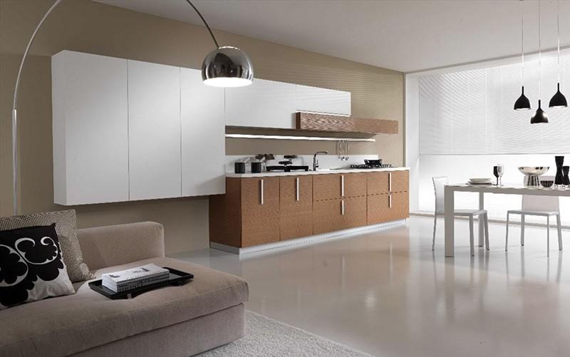 Просторное пространство в бежевых тонах с диваном для отдыха простой формы